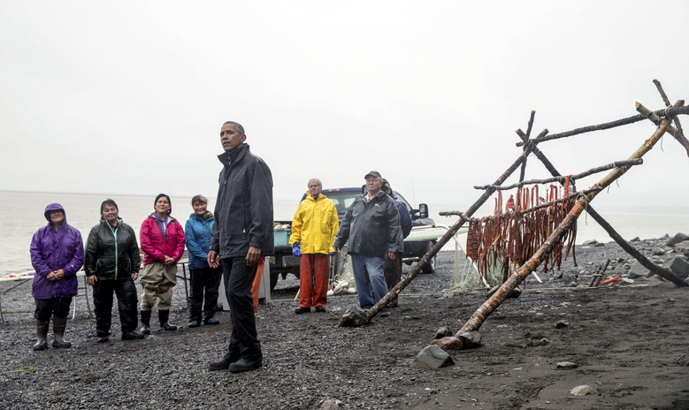 President Barack Obama, accompanied by local fishermen, speaks to members of the media on Kanakanak Beach, Wednesday, Sept. 2, 2015, in Dillingham, Alaska. Obama is on a historic three-day trip to Alaska aimed at showing solidarity with a state often overlooked by Washington, while using its glorious but changing landscape as an urgent call to action on climate change. (AP Photo/Andrew Harnik)