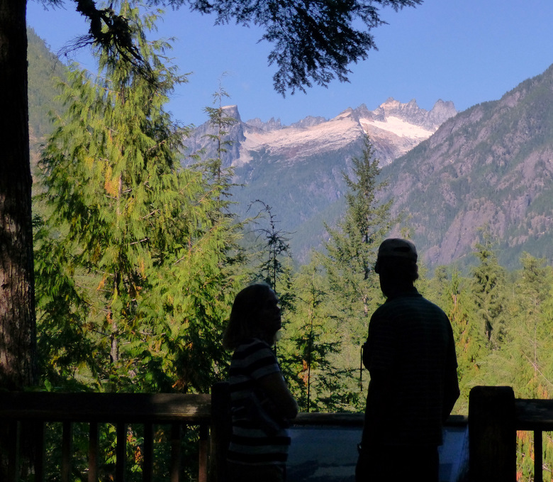Visitors look toward the Picket Range from the Sterling Munro Boardwalk. (Brian J. Cantwell / The Seattle Times)