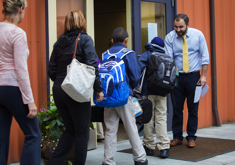 Adel Sefrioui greets parents and students Tuesday at Excel Public Charter School in Kent, which started its fourth week of classes. (Ellen M. Banner / The Seattle Times)