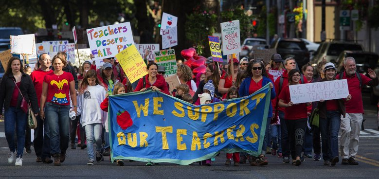 Parents, students and supporters of teachers march to John Stanford Center, Seattle school-district headquarters, Tuesday morning, September 15, 2015.  (Ellen M. Banner/The Seattle Times)