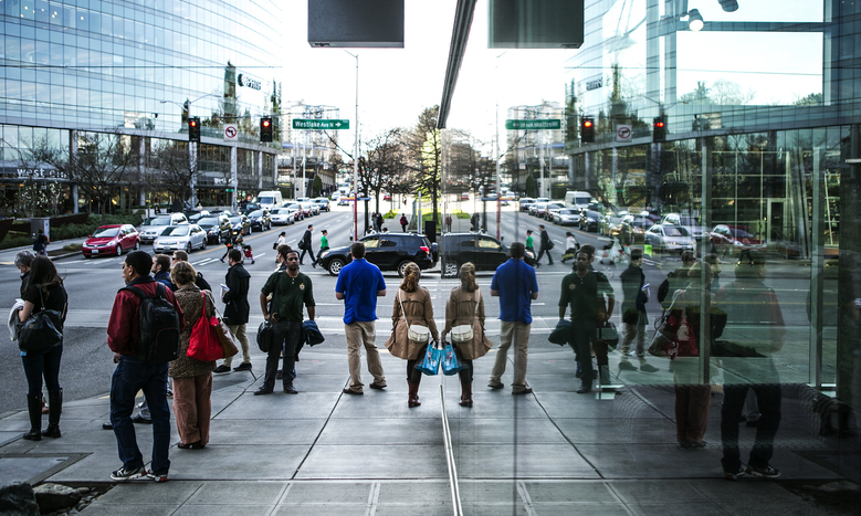 The intersection of Westlake Avenue North and Denny Way bustles with activity at the end of the workday.  (Bettina Hansen/The Seattle Times)