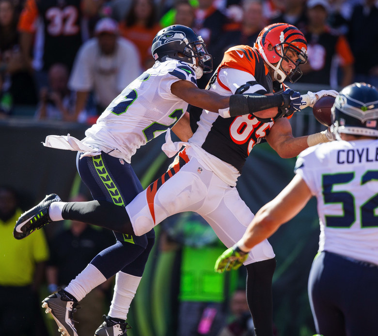 Seattle's Earl Thomas is too far behind Cincinnati's Tyler Eifert to prevent him from scoring on a 10-yard touchdown in the 4th quarter – beginning the Bengal comeback.  The Seattle Seahawks played the Cincinnati Bengals Sunday, October 11, 2015 at Paul Brown Stadium in Cincinnati, OH.  (Dean Rutz / The Seattle Times)