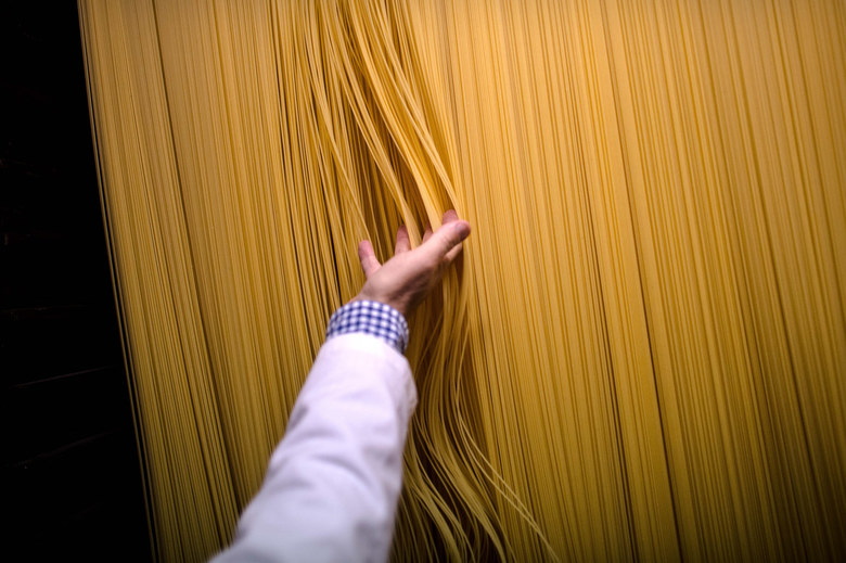 Carles Sanmarti checks noodles drying in wood cabinets at Pasta Sanmarti factory on October 27, 2015 in Caldes de Montbui, Spain. The Sanmarti family has been involved in the production of pasta since 1700. Carles Sanmarti, the 8th generation descendant, still uses the original recipe using just amber durum wheat semolina, thermal mineral water and egg free. Sanmarti nowadays exports their pasta products to countries as diverse as the United States, China, Denmark and also to the United Kingdom, their largest foreign market.  (Photo by David Ramos/Getty Images)
