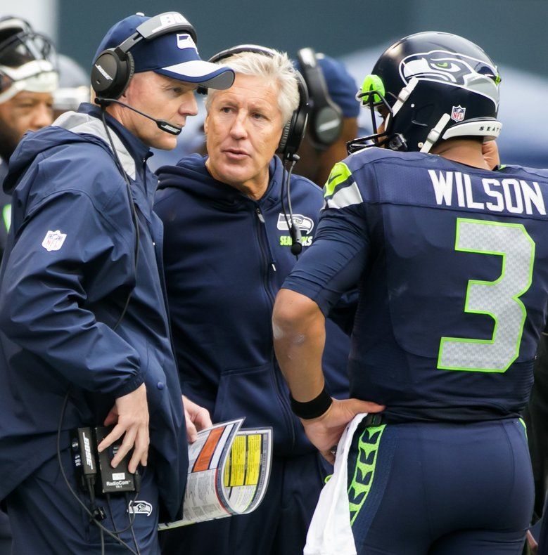 Seahawks fire former Badger QB Bevell, Cable