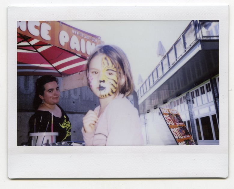 A girl painted to resemble a tiger caught the young photographer's attention on the Seattle waterfront. (Hawkeye Huey)