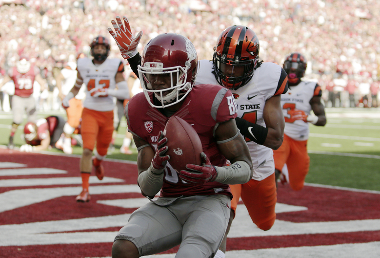 Washington State wide receiver Dom Williams hauls in one of his two touchdown receptions in the first half against Oregon State. (Young Kwak/AP)