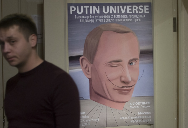 """A man passes by a poster with an artwork showing Russian President Vladimir Putin as Spanish artist Salvador Dali during the """"Putin Universe"""" exhibition in Moscow, Russia, Wednesday, Oct. 7, 2015. Artists have drawn the Russian president using 30 heroic themes originating from different countries and world epochs at a two-day exhibition in Moscow. Russian President Vladimir Putin celebrates his 63rd birthday on Wednesday. (AP Photo/Pavel Golovkin)"""