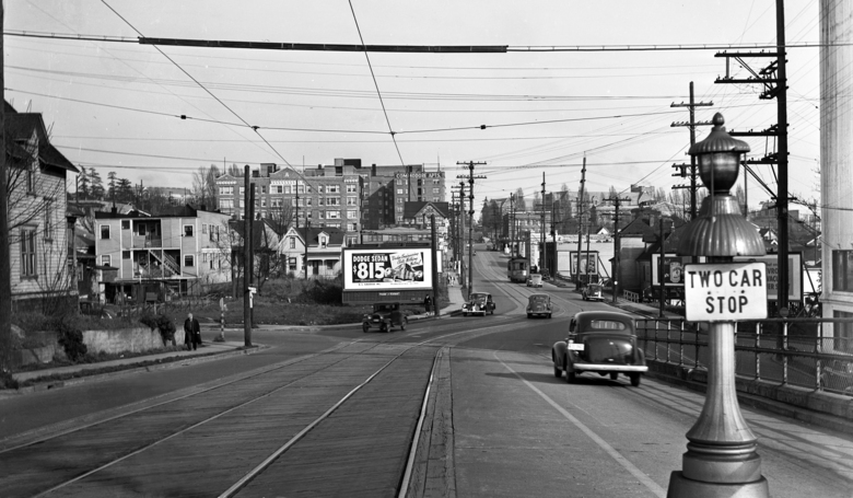 THEN: A sliver of the University of Washington campus building called the Applied Physics Laboratory appears on the far right of this 1940 look east toward the campus from the Northeast 40th Street offramp from the University Bridge. (Courtesy Genevieve McCoy)
