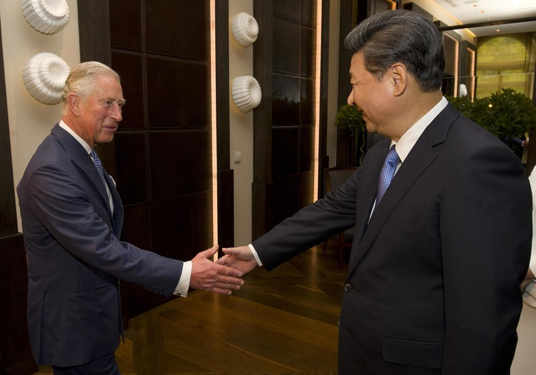 Britain's Prince Charles, left  greets Chinese President Xi Jinping, right, at a hotel in central London, Tuesday, Oct. 20, 2015, on the first official day of a state visit. Chinese President Xi Jinping prepared to address Britain's Parliament and dine with Queen Elizabeth II Tuesday as he began a state visit that is intended to cement close economic ties between the two countries — but risks being overshadowed by concerns over Beijing's growing economic clout in Britain. (Justin Tallis, Pool Photo via AP)
