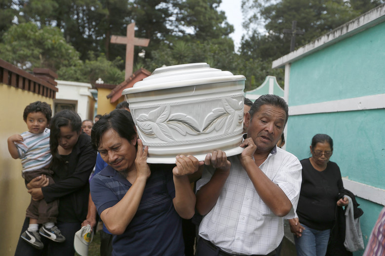 Men carry the coffin of a neighbor who died in a mudslide, to the Santa Catarina Pinula cemetery on the outskirts of Guatemala City, Sunday, Oct. 4, 2015. Hope faded Sunday for finding any survivors of a mudslide that killed at least 87 people as authorities said that hundreds more may still be missing. (AP Photo/Moises Castillo)