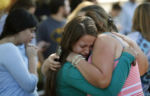 Jessica Vazquez, left, hugs her aunt, Leticia Acaraz, as they await word on Acaraz's daughter after a deadly shooting at Umpqua Community College, in Roseburg, Ore., on Thursday, Oct. 1, 2015. (Andy Nelson/The Register-Guard via AP) MANDATORY CREDIT  OREUG105