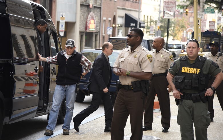 Baltimore city police officers, charged in connection with Freddie Gray's death, including officer Lt. Brian W. Rice, third from left, arrive at a side door, for a court appearance on Tuesday, Oct. 13, 2015 in Baltimore.  All six officers appeared before Judge Barry Williams, who is to determine whether their still undisclosed statements will be allowed at trial. (Barbara Haddock Taylor /The Baltimore Sun via AP)  WASHINGTON EXAMINER OUT; MANDATORY CREDIT