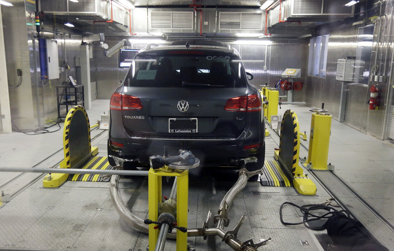 A Volkswagen Touareg diesel is tested in the Environmental Protection Agency's cold temperature test facility, Tuesday, Oct. 13, 2015, in Ann Arbor, Mich. Volkswagen has disclosed to U.S. regulators that there's additional suspect software in its 2016 diesel models that would potentially help their exhaust systems run cleaner during government tests. (AP Photo/Carlos Osorio)
