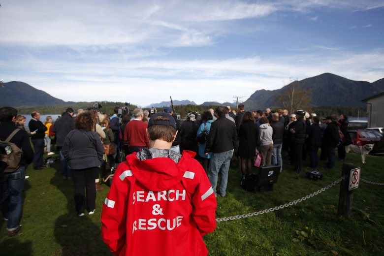 A search and rescue member listens as Premier of British Columbia, Christy Clark thanks members of the Ahousaht First Nation and other first responders involved in the rescue of passengers and crew of the Leviathan II, during a news conference in Tofino, British Columbia,Tuesday, Oct. 27, 2015. Investigators are trying to unravel the mystery of what caused a whale watching boat to capsize off Vancouver Island on Sunday, killing multiple people. (Chad Hipolito/The Canadian Press via AP) MANDATORY CREDIT