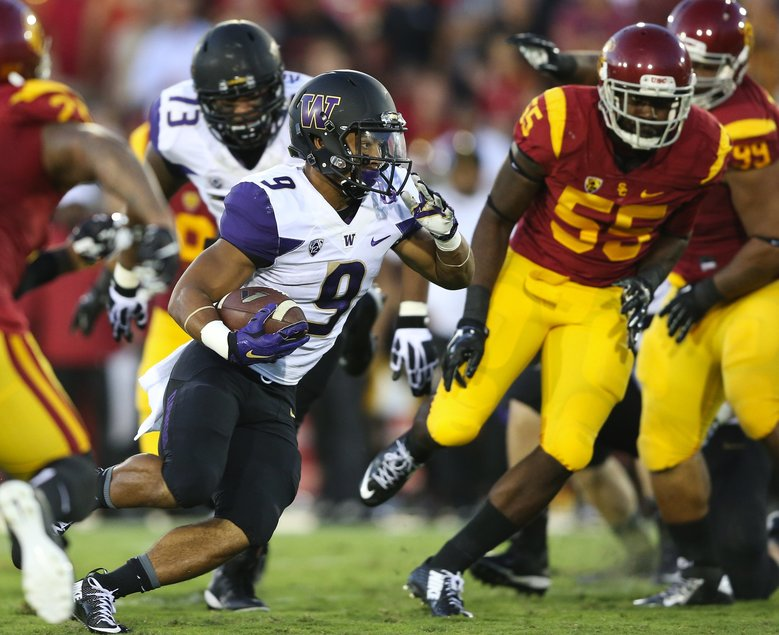 Washington running back Myles Gaskin makes a run for yardage but the play is called back and Washington is penalized 10 yards for offensive holding in the first quarter during the Washington vs. Southern California game in Los Angeles at Memorial Coliseum on Thursday, Oct. 8, 2015. Southern California led 6-3 at the half. Washington entered the game with a 2-2 record, facing former coach Steve Sarkisian for the first time since his abrupt departure for the head coaching job at USC in late 2013.  (Lindsey Wasson/The Seattle Times)