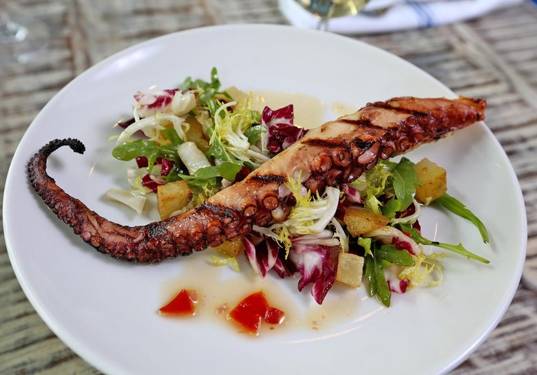 <strong>OMEGA OUZERI:</strong> Octapodi, grilled Mediterranean octopus. (Greg Gilbert/The Seattle Times)