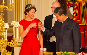 The Duchess of Cambridge and Chinese President Xi Jinping at a state banquet in the Ballroom at Buckingham Palace, London, on the first day of the state visit to the Britain, Tuesday Oct. 20, 2015. (Dominic Lipinski/Pool Photo via AP)