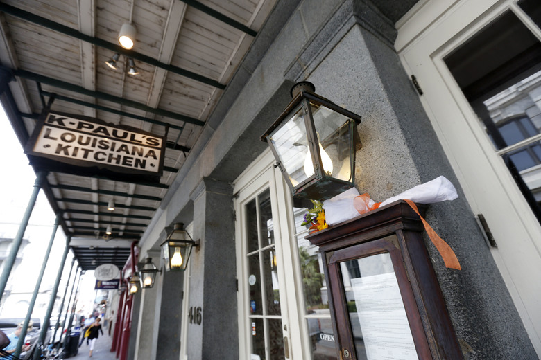 Flowers are placed outside K-Paul's Louisiana Kitchen in the French Quarter of New Orleans, Thursday, Oct. 8, 2015. The proprietor, famed New Orleans Chef Paul Prudhomme, passed away Thursday. He was 75. (AP Photo/Gerald Herbert)