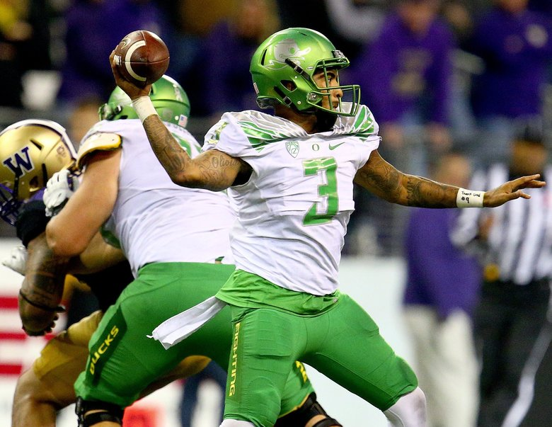Oregon quarterback Vernon Adams finds a target against the Huskies. Adams threw for 272 yards and 2 TDs.  (John Lok/The Seattle Times)