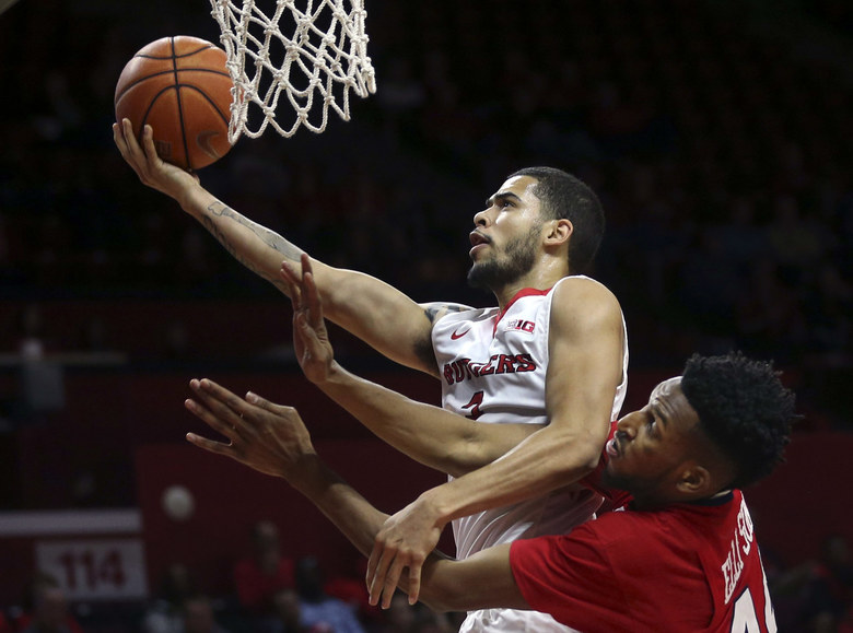 Rutgers guard Bishop Daniels, top, shoots past Howard center Oliver Ellison (44) who blocks his path during the second half of an NCAA college basketball game Sunday, Nov. 15, 2015, in Piscataway, N.J. (AP Photo/Mel Evans)