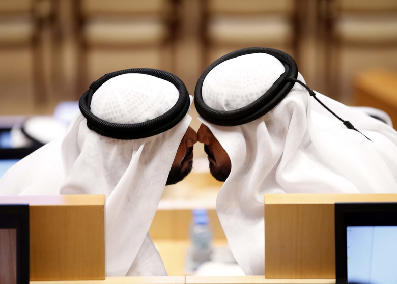 Two new members of the UAE Federal National Council (FNC) greet each other by the UAE traditional kissing during the inaugural session of the new FNC, in Abu Dhabi, United Arab Emirates, November 18, 2015. The 40-member council is the federal authority of the UAE formed to represent the general Emirati people with advisory tasks in the house of legislative council. Twenty members were elected in polls on October 3, while the remaining members, including eight women, were appointed by the rulers of each emirate. Amal Al Qubaisi was elected as speaker of the FNC becoming the first woman to assume the post.  EPA/ALI HAIDER