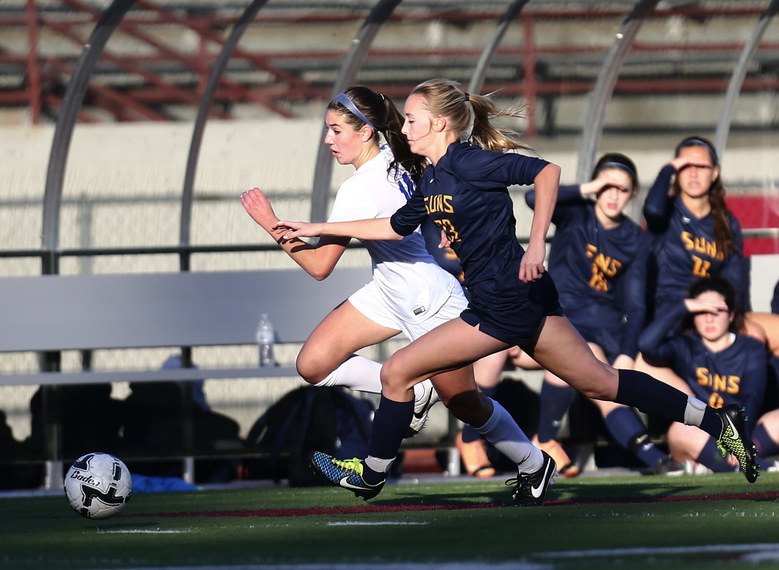 Southridge defender Kendall Pope tries to keep up with Seattle Prep midfielder/forward Sophie Hirst in the first half of the 3A Girls State title match at Sparks Stadium.   (Lindsey Wasson / The Seattle Times)
