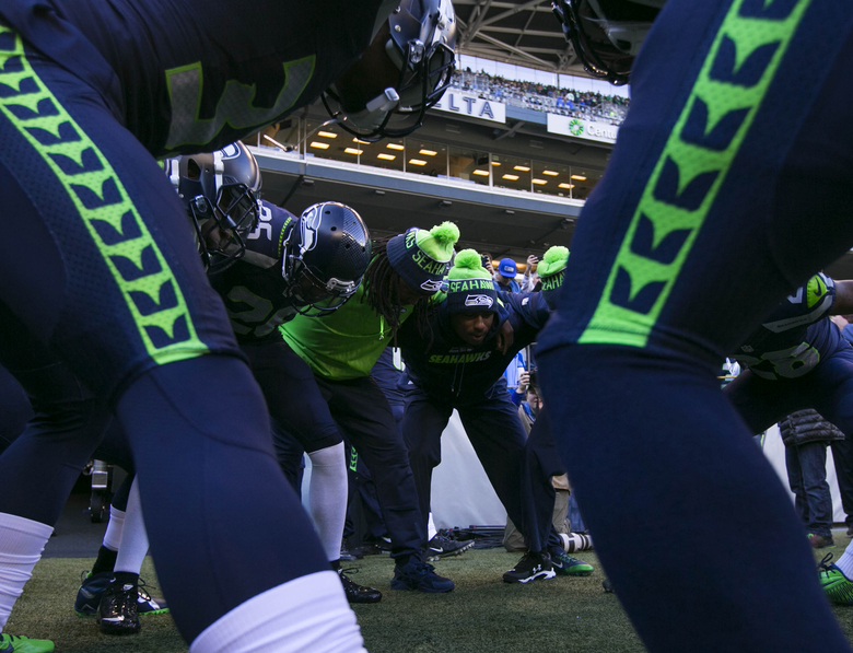 The Seahawks defense heads out for warm ups Sunday. (Bettina Hansen / The Seattle Times)