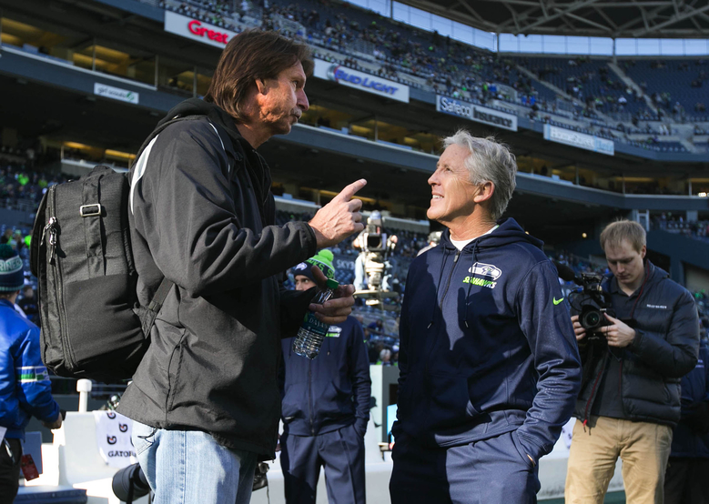 Former Mariners pitcher Randy Johnson talks with Seahawks head coach Pete Carroll before the game. (Bettina Hansen / The Seattle Times)