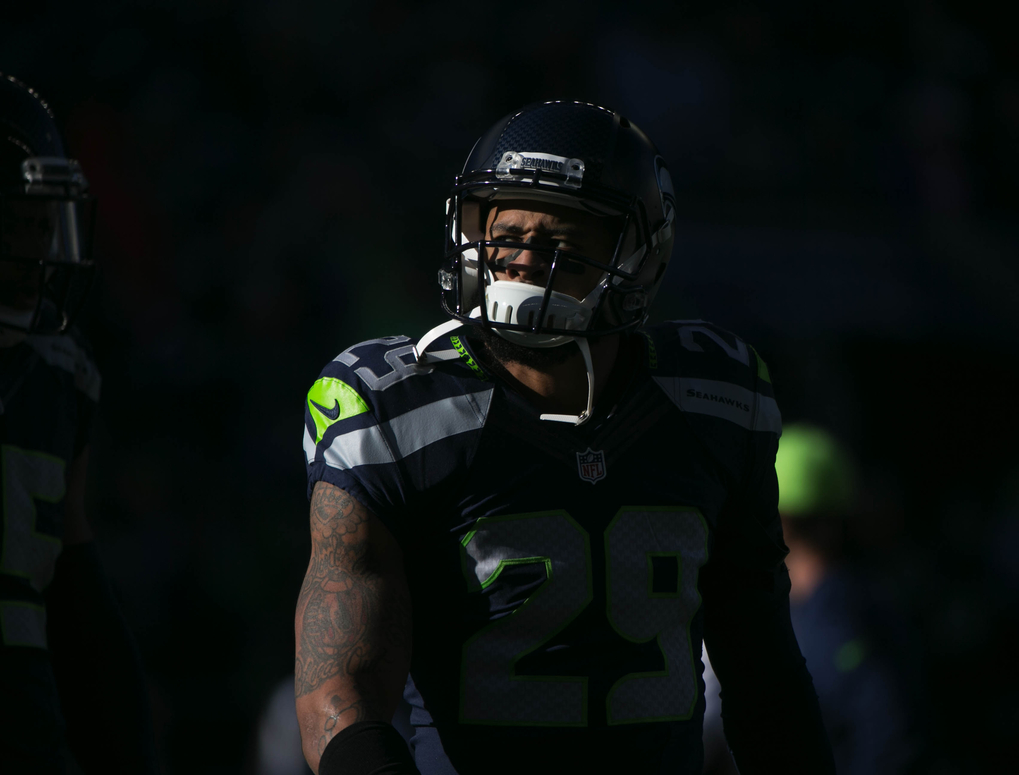 Light crosses Seahawks safety Earl Thomas' face during warmups. (Bettina Hansen / The Seattle Times)