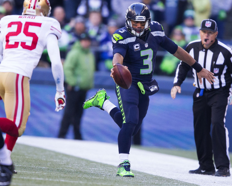 Seahawks quarterback Russell Wilson stretches out for an extra yard on a 5yard pickup in the second quarter. (Dean Rutz / The Seattle Times)