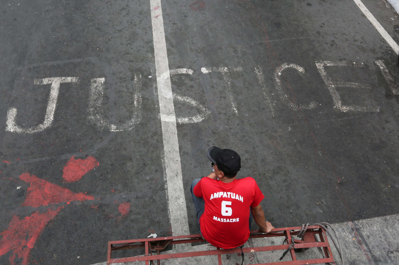 A Filipino human rights advocate rests by the road during a protest march marking the killings of journalists in Manila, Philippines, November 23, 2015. The Maguindanao Massacre is considered Philippines' worst politics-related crime, which left 58 people dead in the southern province of Maguindanao on November 23, 2009. The victims included 32 journalists, making it the single deadliest attack on journalists ever documented, according to the Committee to Protect Journalists.  EPA/MARK R. CRISTINO