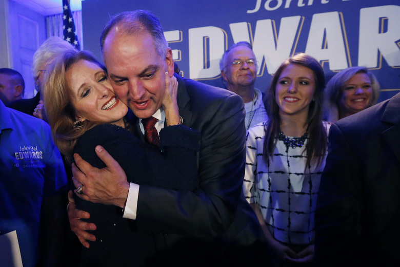 Louisiana Gov.-elect John Bel Edwards hugs his wife Donna Edwards as he arrives to greet supporters at his election night watch party in New Orleans, Saturday, Nov. 21, 2015. At right is his daughter Sarah Ellen Edwards. Edwards won the runoff election for Louisiana governor Saturday, defeating the once-heavy favorite, Republican David Vitter, and handing the Democrats their first statewide victory since 2008. (AP Photo/Gerald Herbert)