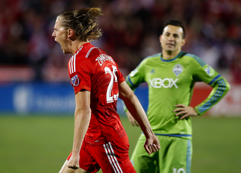 FC Dallas defender Walker Zimmerman (25) reacts to scoring the teams second goal as Seattle Sounders FC midfielder Marco Pappa (10) looks on during the second half of an MLS soccer western conference semifinal playoff match, Sunday, Nov. 8, 2015, in Frisco, Texas. (AP Photo/Brad Loper) — TXBL208 (Brad Loper/AP)