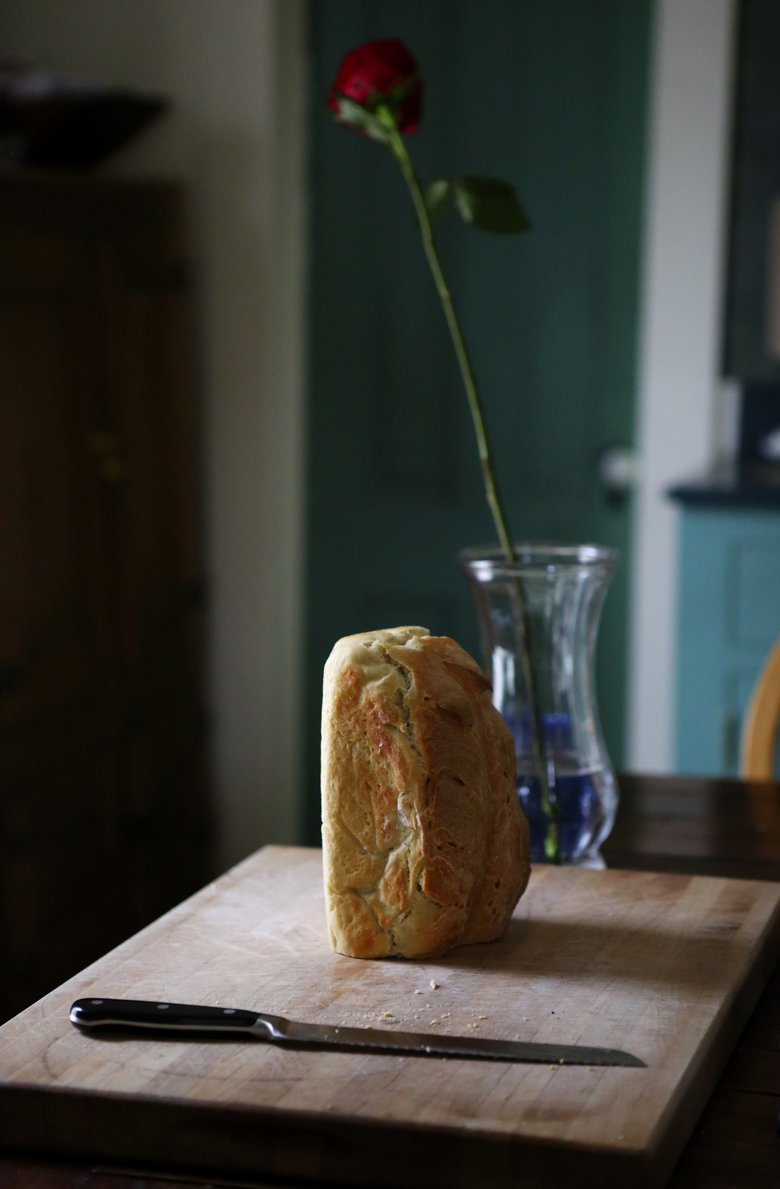 Homemade bread and a fresh-cut rose await dinner at the Chrisman home in Port Townsend. (Ken Lambert/The Seattle Times)