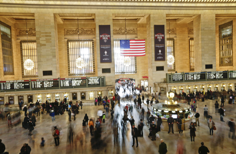 FILE – In this Nov. 25, 2015 file photo, people move about Grand Central Station in New York. According to AAA, 42 million traveled somewhere to celebrate Thanksgiving. Tens of millions of Americans returning home after the long Thanksgiving holiday weekend Sunday have cooperative weather and mostly efficient airport operations to thank for smooth traveling conditions. (AP Photo/Frank Franklin II, File)