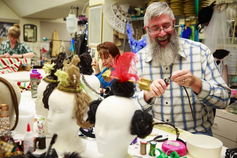 Terry Frank, working in PNB's costume shop in Seattle, makes hairpieces out of tubular horsehair, pipe cleaners and decorative pieces. (Erika Schultz/The Seattle Times)