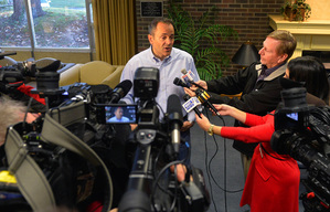 Kentucky Republican gubernatorial candidate Matt Bevin, center, speaks with reporters after casting his vote in the Kentucky general election, Tuesday, Nov. 3, 2015, in Louisville, Ky. (AP Photo/Timothy D. Easley)