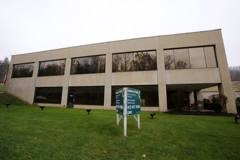 This Tuesday, Nov. 10, 2015 photo shows the office building, owned by BenCan LLC, and INBS LLC, in Mount Lebanon, Pa. Republican presidential contender Ben Carson has maintained a business relationship with a close friend, Pittsburgh dentist Alfonso Costa, convicted of defrauding insurance companies, even as the candidate has called for such crimes to be punished harshly. In 2007, a few months before Costa was charged, records show that a pair of corporations was established in Pennsylvania called BenCan LLC, and INBS LLC. Carson and his wife are listed as the sole members of the companies. (AP Photo/Gene J. Puskar)