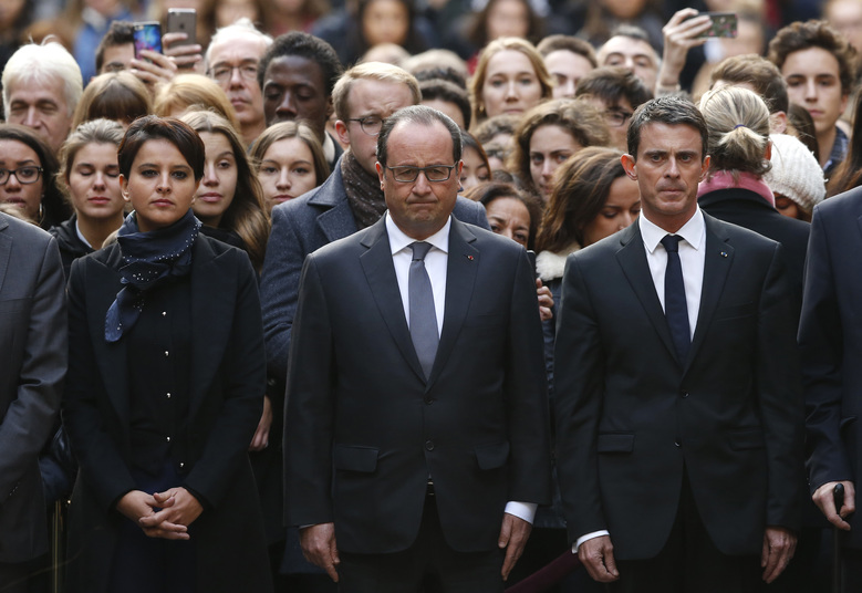 French President Francois Hollande, center, flanked by French Prime Minister Manuel Valls, right, and French Education Minister Najat Vallaud-Belkacem, center left, stands among students during a minute of silence in the courtyard of the Sorbonne University in Paris, Monday, Nov. 16 2015. While few in the war-weary West want to send ground troops to the areas controlled by Islamic State, it may actually be even harder to find anyone arguing that the aerial bombardment strategy will soon succeed in defeating the radical jihadi group. That is the fundamental contradiction faced by policymakers as they grapple with the meaning of the Paris attacks. (Guillaume Horcajuelo, Pool via AP)