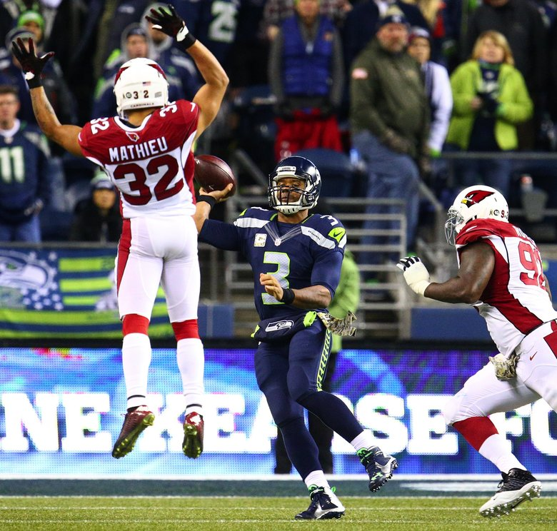 Seahawks quarterback Russell Wilson attempts a pass over Cardinals safety Tyrann Mathieu in last Sunday's game. Wilson completed just 44 percent of his passes, his worst since the second game of the 2013 season.  (John Lok/The Seattle Times)