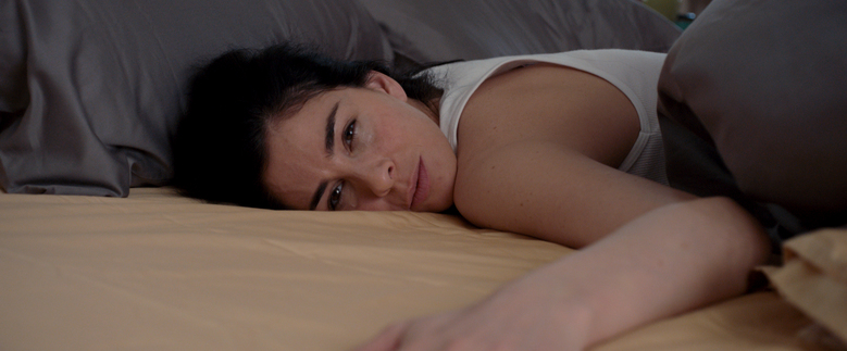 """Sarah Silverman shifts from comedy to play a suburban wife and mother who is hooked on alcohol and drugs in """"I Smile Back.""""  (Broad Green)"""