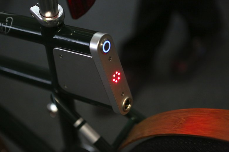 The control area is under the seat on this bike. On/off button is at top; charging outlet at bottom. (Ken Lambert / The Seattle Times)