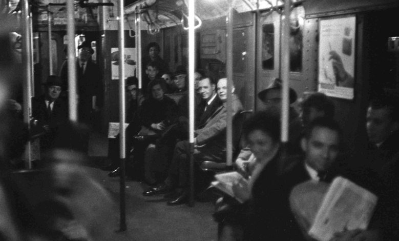 FILE – In this Nov. 9, 1965 file photo, passengers sit patiently in near-darkness in a stalled subway car at West 4th Street in the Manhattan section of New York, during the massive power failure that struck at 5:27 p.m., the height of the evening commute. Stretching across the northeastern U.S. and southern Canada, in New York it trapped hundreds of thousands of subway riders in their train cars, stranded others in building elevators, and turned Grand Central Terminal into an ad-hoc bedroom for commuters who couldn't get home. (AP Photo/Jerry Mosey, File)