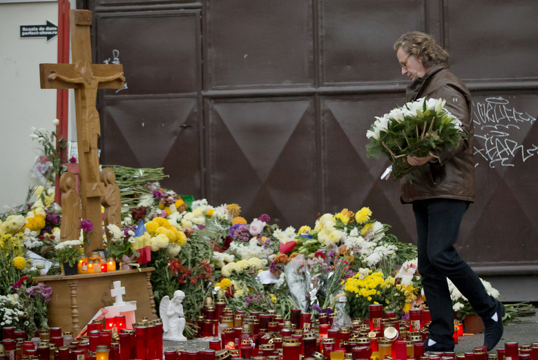 Dutch violinist and conductor Andre Rieu lays flowers outside the Colectiv nightclub in Bucharest, Romania, Saturday, Nov. 7, 2015. Seven more people have died a week after a fire broke out in a Bucharest nightclub. About 100 other people still remain hospitalized, of which 48 are in a serious or critical condition, from the Oct. 30 blaze that erupted at the Colectiv nightclub during a heavy-metal concert.(AP Photo/Vadim Ghirda)