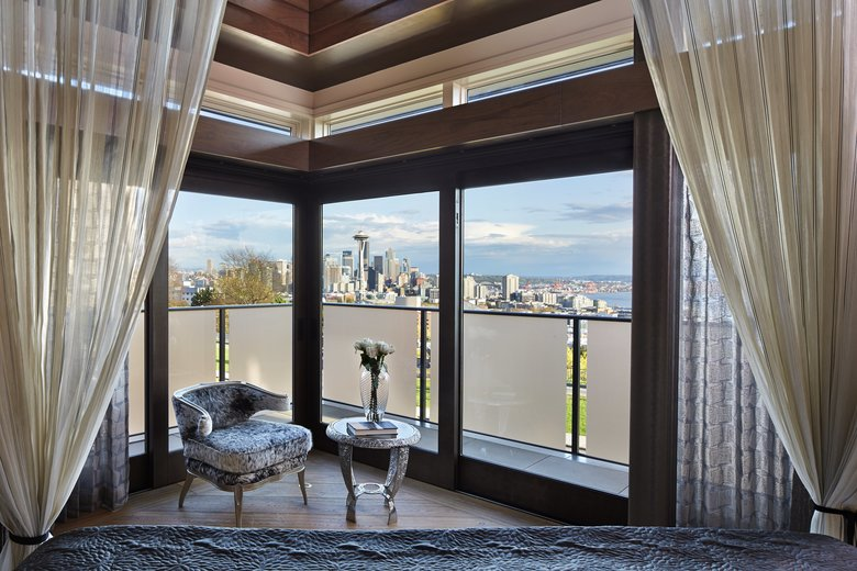 The canopy curtains in the master bedroom, which has a panoramic view of the city, are shirting voile from Switzerland. (Benjamin Benschneider/The Seattle Times)