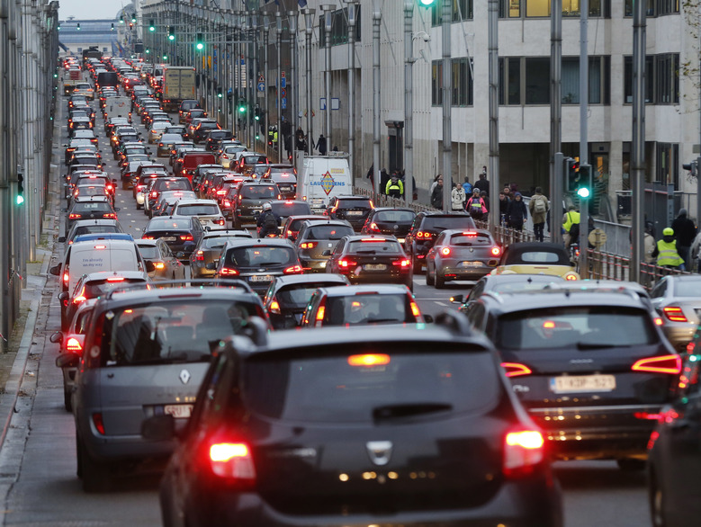 Traffic lines a street in Brussels, Belgium, Tuesday, Nov. 24, 2015. Brussels is keeping its terror alert at the highest level. (AP Photo/Michael Probst)