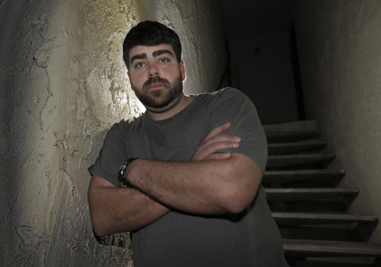In this photo taken Thursday, Dec. 17, 2015, Josh Redmyer, a former Marine who served three tours in Iraq, poses in Oroville, Calif.  Redmyer, who was diagnosed with Post-Traumatic Stress Disorder in 2009,  received a less-than-honorable discharge in 2012. He is among the thousands of veterans who cannot receive veterans health benefits because of a less-than-honorable discharge. (AP Photo/Rich Pedroncelli)