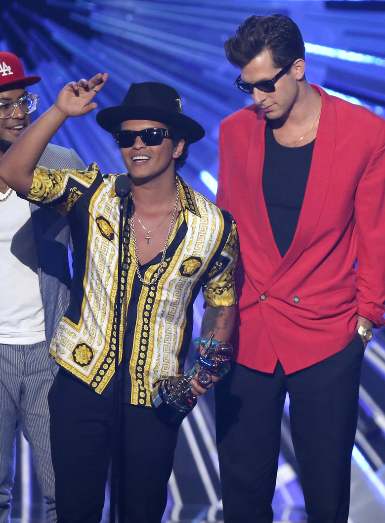 "FILE – In this Aug. 30, 2015, file photo, Bruno Mars, left, and Mark Ronson accept the award for male video of the year for ""Uptown Funk"" at the MTV Video Music Awards in Los Angeles. Ronson and Mars' ""Uptown Funk"" is one of the nominees for record of the year at the Grammys on Feb. 15, 2016. (Photo by Matt Sayles/Invision/AP, File)"