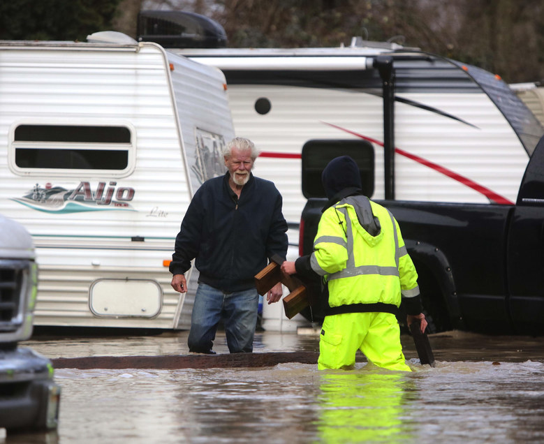 Flood updates: High waters, road and school closures, power outages ...