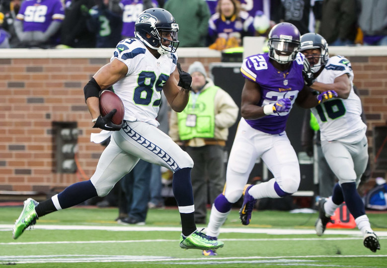Seahawks wide receiver Doug Baldwin runs in a 53-yard touchdown in the third quarter, immediately after another 53-yard rushing touchdown by Russell Wilson was called back, as the Seattle Seahawks defeated the Minnesota Vikings 38-7 at the TCF Bank Stadium in Minneapolis Sunday December 6, 2015. (Bettina Hansen / The Seattle Times)